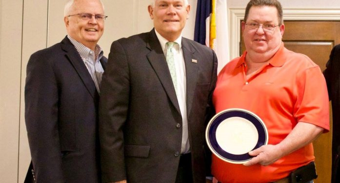 Simmons honored for years of service
